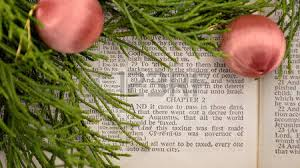 open bible with greenery and ornaments bible open to gospel