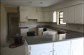 dark grey countertops with white cabinets kitchen remodel with custom countertops kitchen cabinets mn