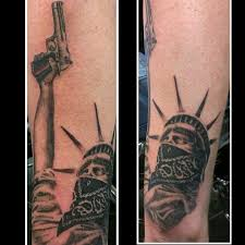 blue statue of liberty tattoo on arm real photo pictures images
