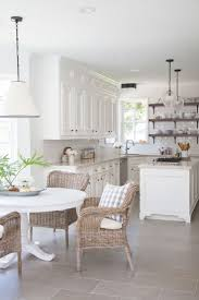 all white home interiors kitchen dining set and pendant lighting with white subway tile