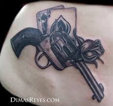 50 most amazing pistol tattoo design pictures