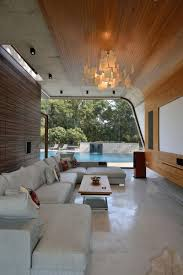 poolhouse a curved concrete contemporary pool house in india home design lover
