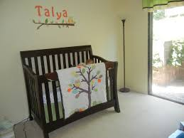 green tree wall decal closed to small nursery room bench with animals nursery wall decal