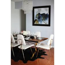 jonathan adler maxime dining chair in linen and brass candelabra