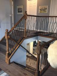 Chrome Banister Bent Iron Design Interior Railing With A Distressed Wood Handrail
