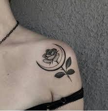 grey flower and moon on left shoulder