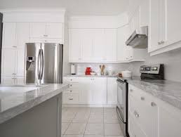white shaker kitchen cabinets with white subway tile backsplash white shaker kitchen cabinets with marble countertops