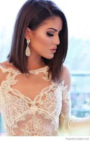 big ear rings amazing bob hair cut with big earrings and lace dress
