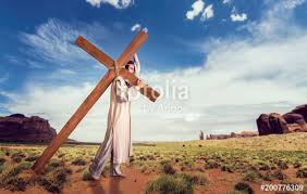 great martyr with cross in desert sun rays stock photo and