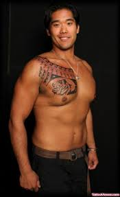 man with tribal word chest tattoo tattoo viewer com