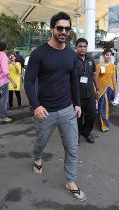 celebs spotted at airport john abraham cricketer shikhar dhawan