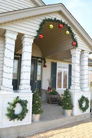 fashion a diy christmas topiary from a basic tomato cage diy front porch christmas decorations