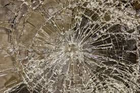 glass broken but held together with security film stock photo