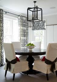 black pedestal dining table slipcovered dining chairs transitional dining room an