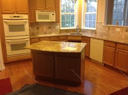 kitchen beige mosaic strip backsplash tile and marble countertop