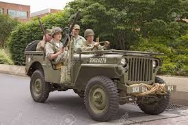 ww2 jeep front reenactment of world war ii jeep and infantrymen driving in 1940s