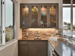 kitchen cabinet door with glass kitchen cabinet doors with glass create a beachy vibe in a