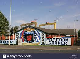 bright wall painted ulster defence association murals on bright wall painted ulster defence association murals on newtownards road with famous yellow harland and wolff