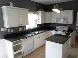 kitchen white pendant light white corner cabinets black granite