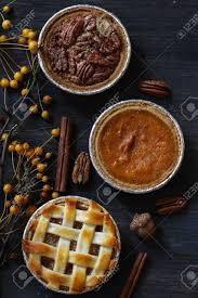 overhead view of three mini pies apple pie pumpkin pie and
