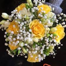 cheerful cape cod summer wedding white wedding bouquets yellow