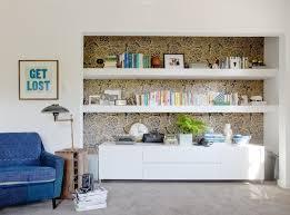 petal pushers wallpapers oh joy wallpaper in black u0026 gold behind this shelving area