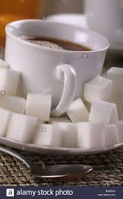 where to buy sugar cubes tea or coffee drink with lots of sugar cubes stock photo 27473210