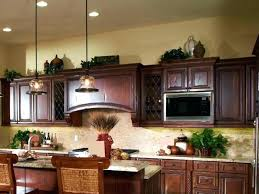 what do you put on top of kitchen cabinets what do you put on top of kitchen cabinets install crown molding