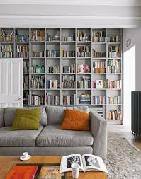 this grey living room with floor to ceiling bookcases uses a