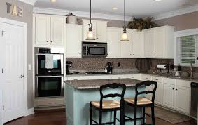 tile countertops white kitchen cabinets with appliances lighting