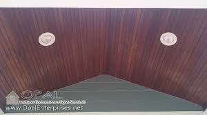 Outdoor Wood Ceiling Planks by Dark Wood Porch Ceiling With Blue Hardie Plank Siding