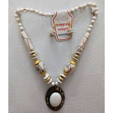 golden necklace women images Elegant white and golden necklace with red oval shaped pendant jpg