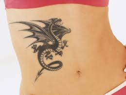black ink dragon tattoo on right hip