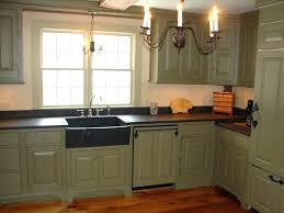 granite countertopssage green kitchen cabinets with black