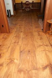 wide plank eastern white pine with a custom stain and a tung