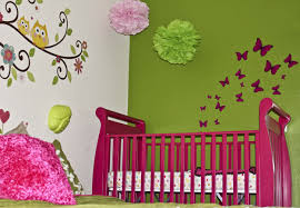 white green toddler room wall with butterfly and owl paint
