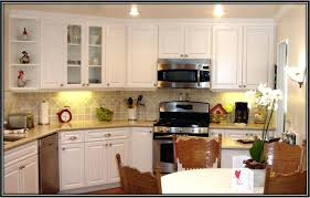 spray painting kitchen cabinets painting kitchen cabinets white
