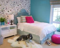 girls bedroom decorating ideas on a budget pretty butterfly wallpaper with teal colored bed for inexpensive