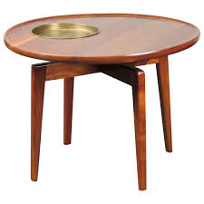 rare sculptural walnut table with brass plant stand by jens risom
