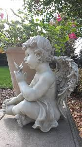 cherub butterfly garden statue on sale at wing and a prayer