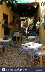Restaurant Patio Tables by Outdoor Tables At A Traditional Greek Restaurant In Rhodes City