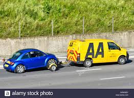 yellow volkswagen beetle royalty free aa breakdown van towing a vw beetle car on the m25 uk motorway