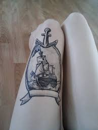 black ink boat with anchor and ribbon tattoo on thigh by starbuxx