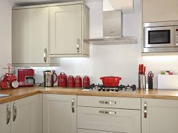 kitchen with stainless steel appliances and red kitchen