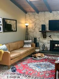 stone wall fireplace in living room vaulted wood ceiling beams