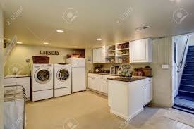 White Cabinets For Laundry Room Large Laundry Room With Appliances And White Cabinets Stock Photo