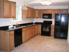 Kitchen With Black Cabinets Kitchen With Oak Cabinets With Black Appliances Bing Images