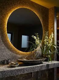 ultra dark bathroom interior with led retrofitted oval mirror