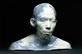 porcelain busts imprinted with decorative designs by ah