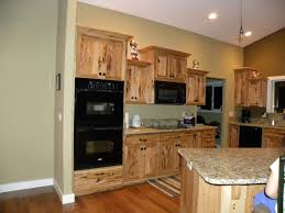 modern kitchen with hanging oak cabinet and brown wooden f island